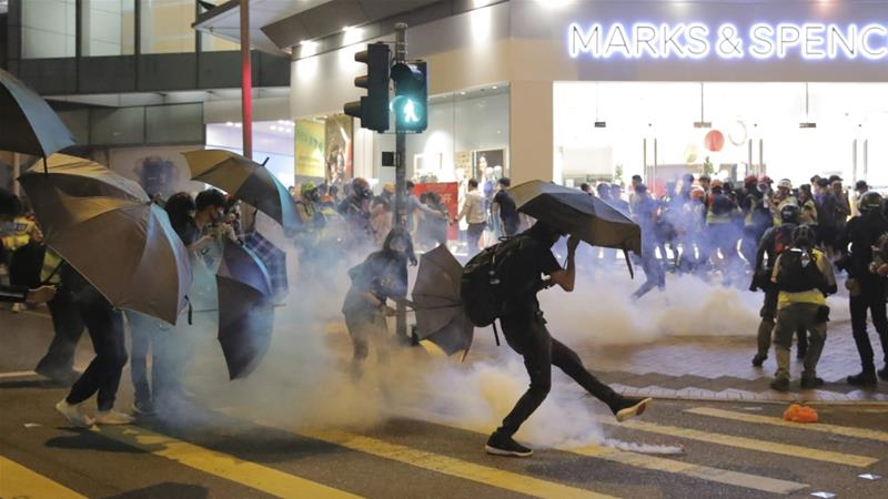 Police officer shoots protester in Hong Kong
