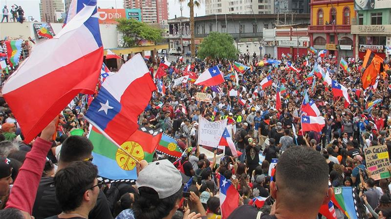 After a union-led march through downtown Antofagasta, thousands gather to protest [Sandra Cuffe/Al Jazeera]