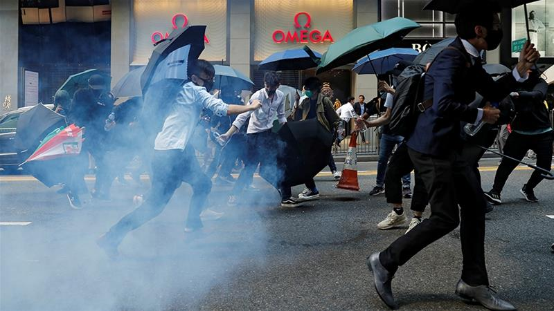 Hong Kong's financial district has not been spared the violent anti-government protests, which have disrupted business and commercial activities nearly six months [File: Tyrone Siu/Reuters]