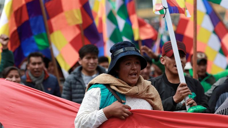 Situation in Bolivia is uncertain as supporters of former President Morales reject interim president Jeanine Anez's move for the leadership [Henry Romero/Reuters]