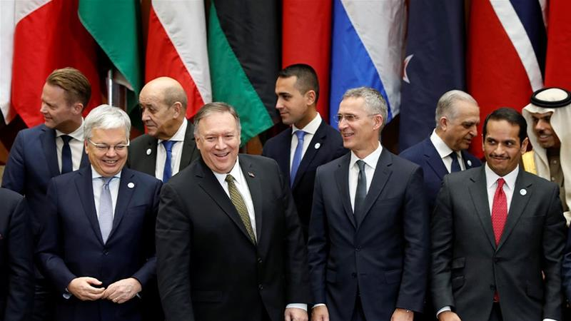 US Secretary of State Mike Pompeo and other foreign ministers and officials pose for a group photo during the Global Coalition to Defeat ISIS Small Group Ministerial at the State Department [Yara Nardi/Reuters]