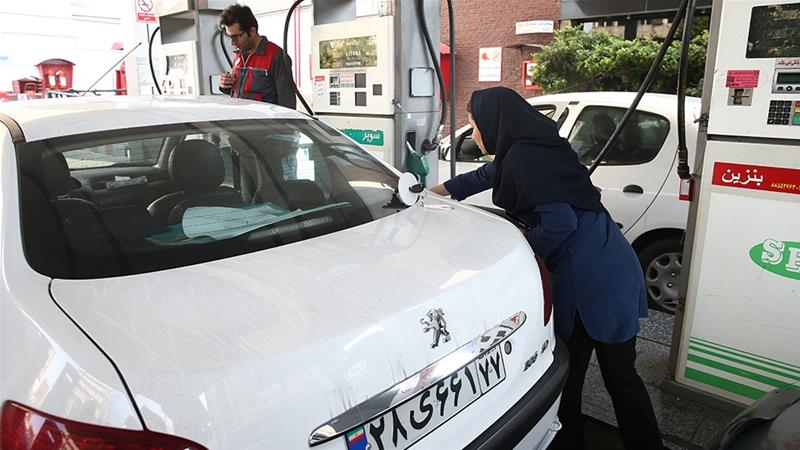 Iranians queued at petrol stations after fuel rationing and price hikes were announced [File: Nazanin Tabatabaee/WANA/Reuters]