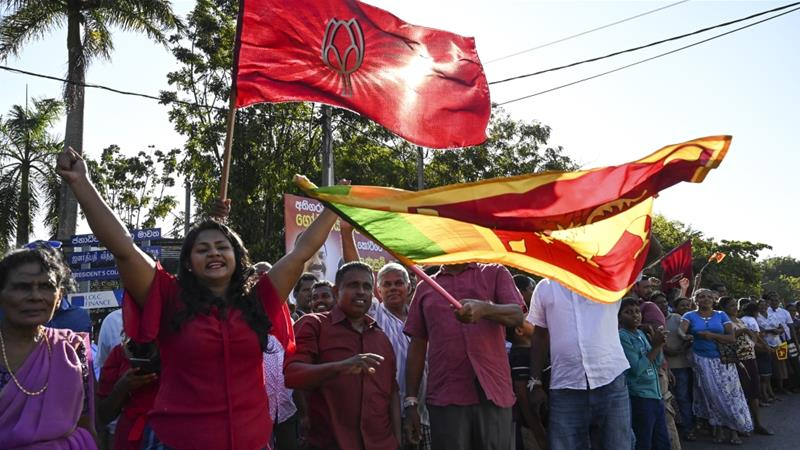 Supporters of Sri Lanka's President-elect Gotabaya Rajapaksa cheer near the Election Commission office in Colombo [S Kodikara/AFP]