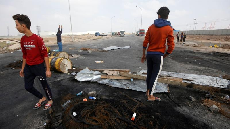 If the blockage of roads leading to Iraq's Umm Qasr Port continues, operations will come to a complete halt, say port officials [Essam al-Sudani/Reuters]