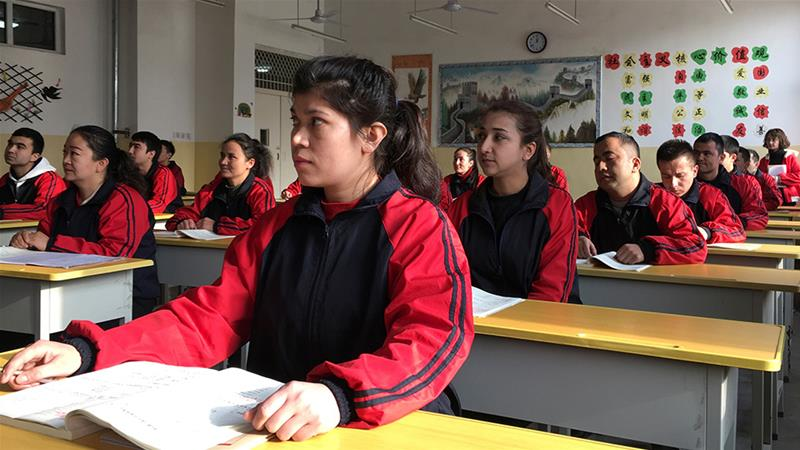 People at the Kashgar city vocational educational training centre attend a Chinese lesson during a government-organised visit in January this year [File: Ben Blanchard/Reuters]
