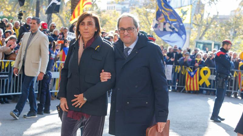 Quim Torra, a former insurance executive, and his wife Carola Miro leave Barcelona's High Court [Enrique Calvo/Reuters]