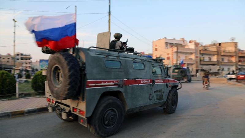 Russian military police patrol an area at Qamishli, northern Syria [File: Ahmed Mardnli/EPA]
