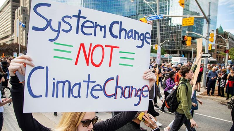 People take part in a climate change strike in Toronto, Ontario [File: Carlos Osorio/Reuters]