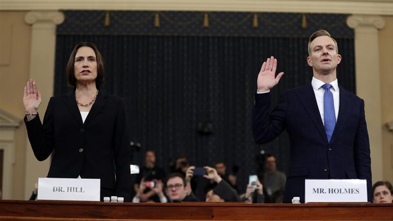 Fiona Hill and David Holmes are sworn in to testify before the House Intelligence Committee on Capitol Hill [Andrew Harnik/AP Photo]