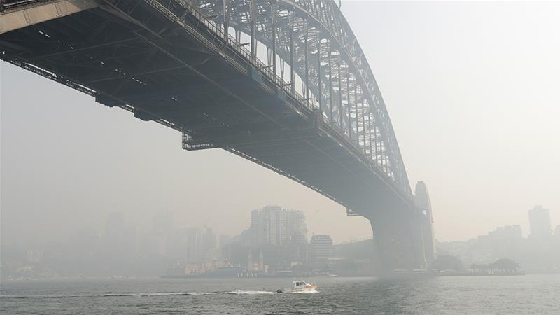 The smoke from bushfires ravaging parts of Australia has drifted across its biggest cities, including Sydney [Rick Rycroft/AP Photo]