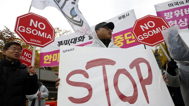 South Korean protesters shout slogans during a rally to oppose the renewal of the General Security of Military Information Agreement (GSOMIA) with Japan [Jeon Heon-Kyun/EPA]