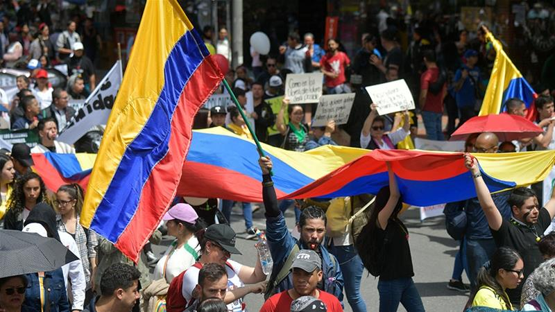 Colombian demonstrators take part in a demonstration during a nationwide strike called by students, unions and indigenous groups to protest against the government of Colombia''s President Ivan Duque [Raul Arboleda/AFP]