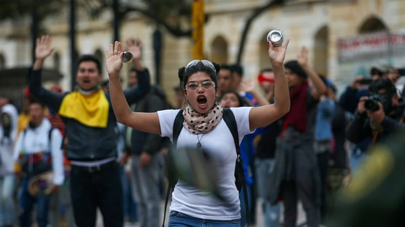 Demonstrators raise their hands as protests continue in Bogota [Luisa Gonzalez/Reuters]