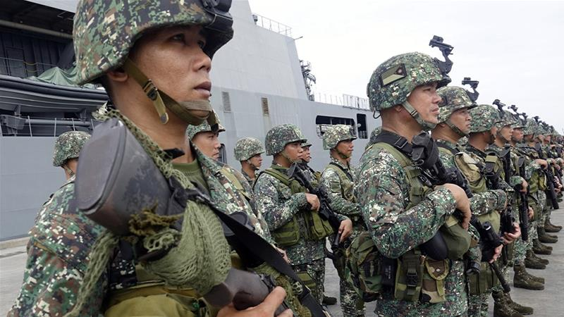 A military report said the fighters were believed to be led by Abu Sayyaf commanders Radulan Sahiron and Hatib Hajan Sawadjaan, who have been blamed for kidnappings for ransom and beheadings [File: Laurenz Castillo/EPA]