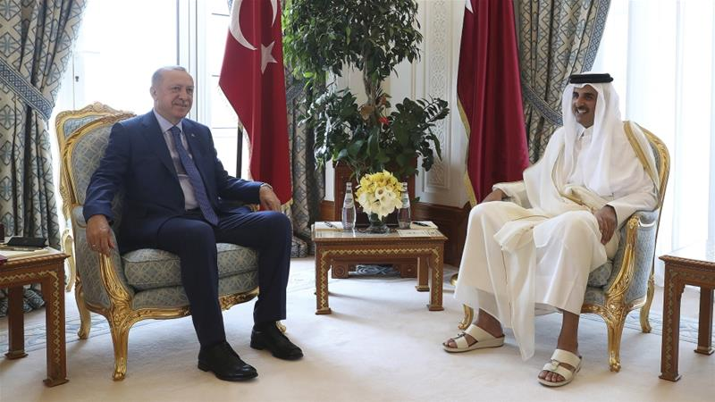 President Erdogan and Sheikh Tamim pose for photos for the media before their meeting in Doha [Presidential Press Service via AP]