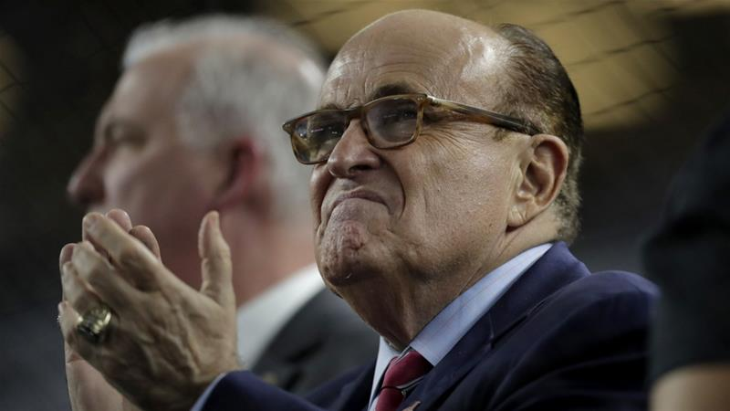 Rudy Giuliani assured the president he was only joking about 'insurance' if 'thrown under the bus' [Julio Cortez/AP]