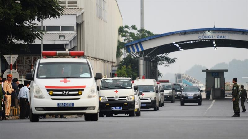 Vehicles carrying some of the remains leave Noi Bai airport in Hanoi on Wednesday morning [Nhac Nguyen/AFP]