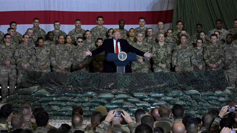 US President Donald Trump addresses troops at Bagram Air Field in Afghanistan in 2019. Administration officials have played down reports that the US had intelligence Russia was paying Taliban fighters to kill US troops in the region [File: Olivier Douliery/AFP]