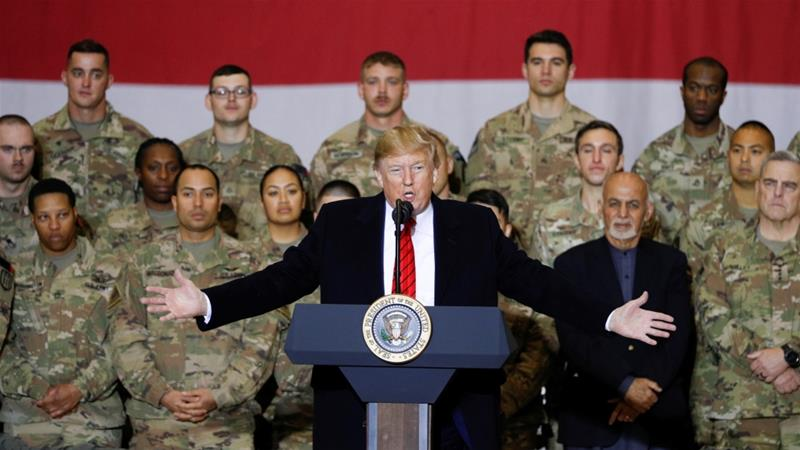 The unannounced Thanksgiving visit was Trump's first to Afghanistan since becoming president [Tom Brenner/Reuters]