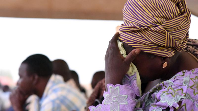 Family members of victims of an ambush on workers near a Canadian-owned mine, react during their meeting with officials in Ouagadougou, Burkina Faso November 7, 2019 [Anne Mimault/Reuters]