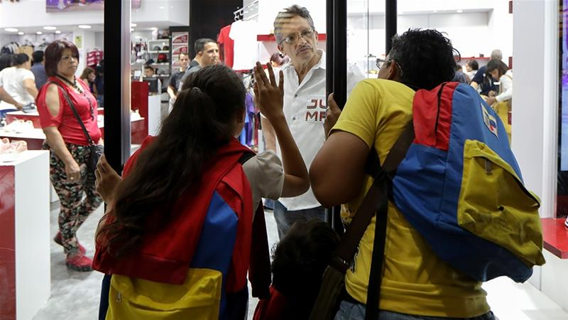 Shopping malls and retailers across Venezuela advertised deep discounts on Friday as the socialist government of President Nicolas Maduro tried to temporarily ease the effect of the country's economic crisis on its citizens [File: Manaure Quintero/Reuters]