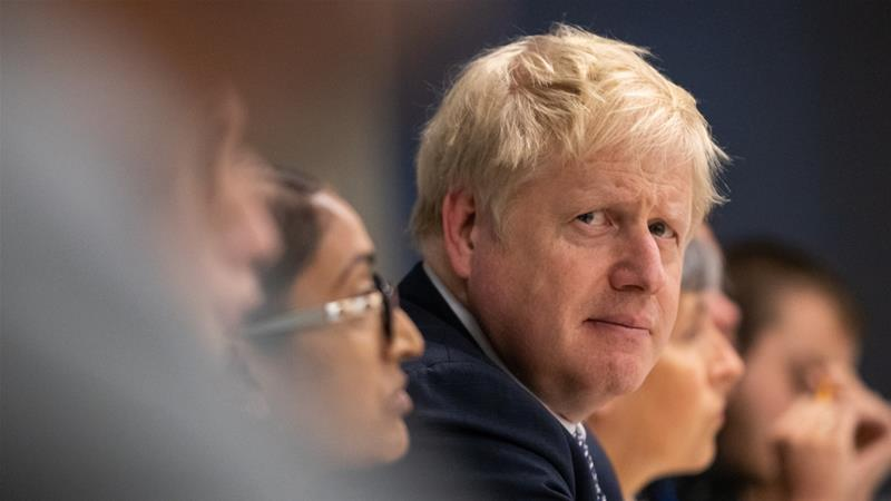 Johnson's failure to deliver on Brexit by October 31 may cost him some backing from voters drawn to his fiery rhetoric [File: Aaron Chown/Getty Images]