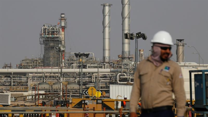 An employee looks on at the Aramco oil facility in Abqaiq, Saudi Arabia [File: Maxim Shemetov/Reuters]