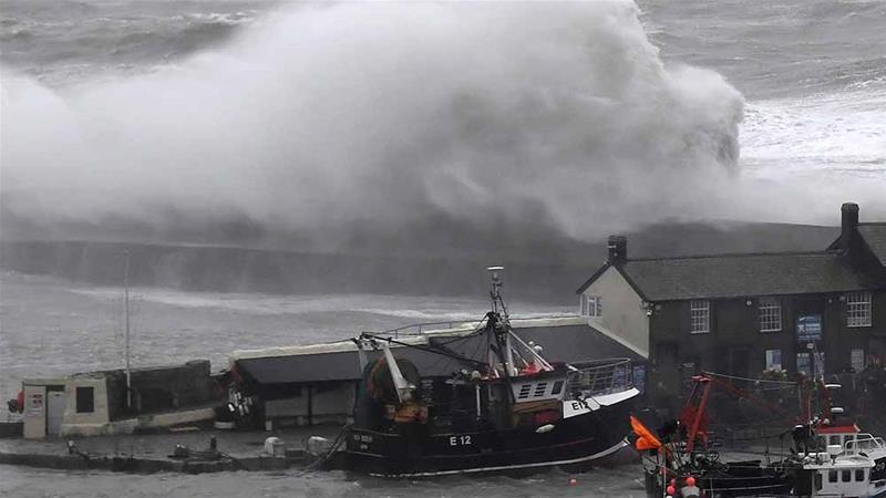 Large waves crash against the harbour during high winds at Lyme Regis, southwest Britain [Toby Melville/Reuters]