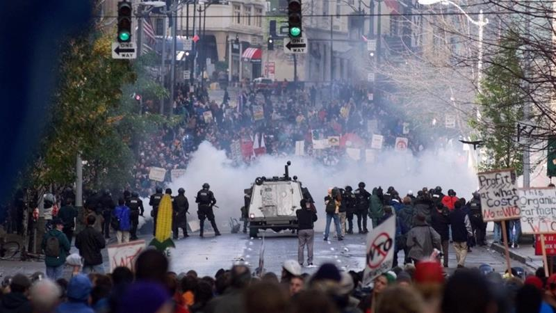 Seattle police use gas to push back World Trade Organization protesters in downtown Seattle on November 30, 1999. The protests delayed the opening of the WTO conference [AP/Eric Draper] [Daylife]