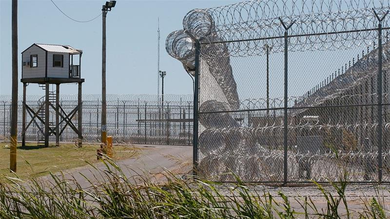 This July 10, 2017, file photo shows a tower outside of the razor wire at the Great Plains Correctional Facility in Hinton, Oklahoma [File: Sue Ogrocki/AP Photo]