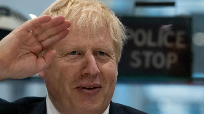 Boris Johnson is leading the Conservatives into a December 12 election [Aaron Chown/Pool/Reuters]