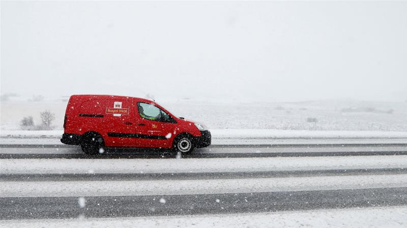 A Royal Mail van drives through the Drumochter Pass, Scotland [Russell Cheyne/Reuters]