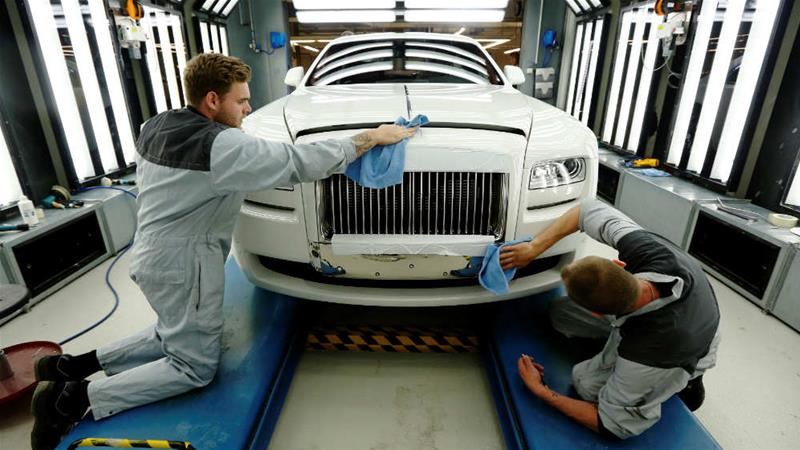 A Rolls Royce Ghost gets its final finish polish at the Rolls Royce Motor Cars factory at Goodwood near Chichester in southern England [Luke MacGregor/Reuters]