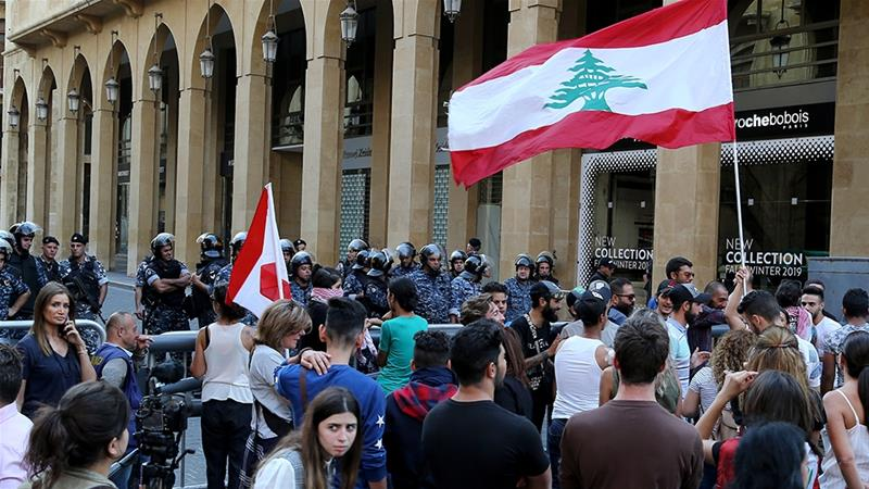 Lebanon protests move from blocking roads to surrounding state bodies