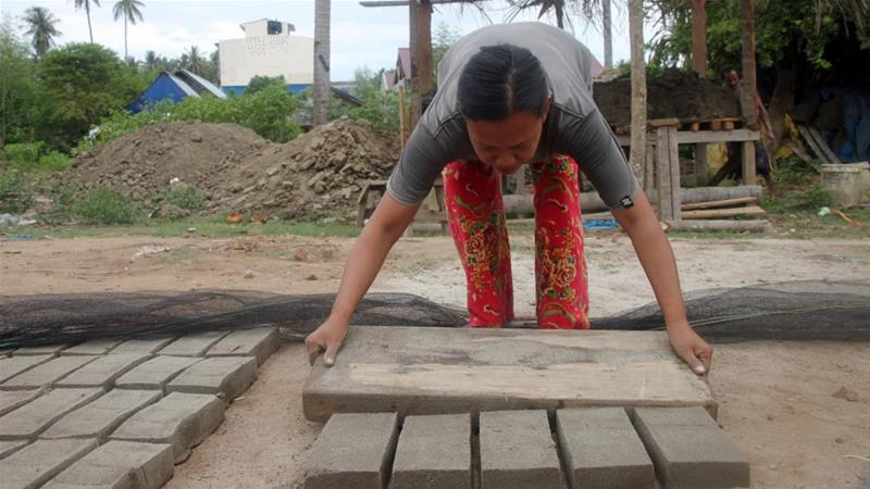 Brick by brick, a family rebuilds after Indonesia's earthquake