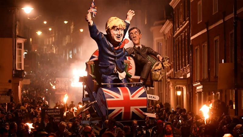 Effigies of Boris Johnson and Jacob Rees-Mogg were burned during the annual Bonfire Night festivities in Lewes on Tuesday night [Toby Melville/Reuters]