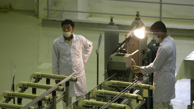 Iranian technicians work at a new facility producing uranium fuel for a planned heavy-water nuclear reactor, just outside the city of Isfahan [File: Vahid Salemi/AP Photo]