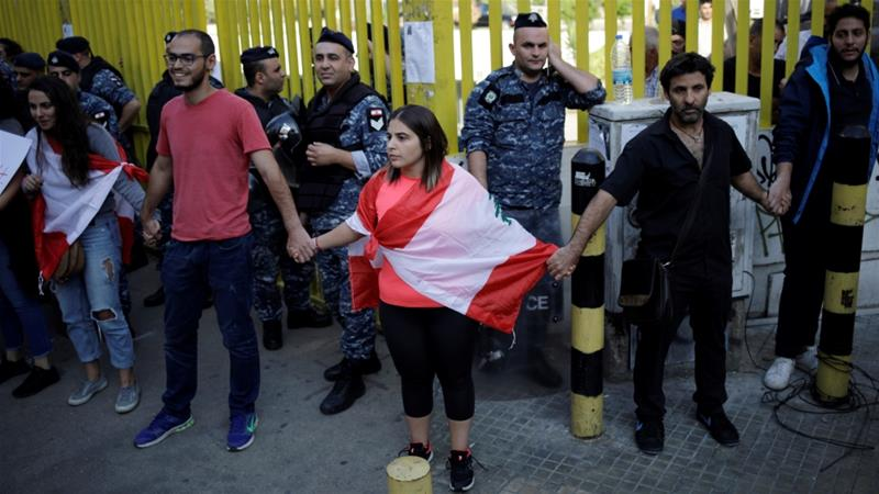 Demonstrators block access to the state-owned electricity company during anti-government protests in Beirut, Lebanon [Andres Martinez Casares/Reuters]