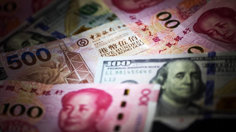 The net worth of China's richest dropped 12.8 percent in dollar terms on the back of tumbling stock markets, a weaker local currency and a slowdown in growth, the report found [File: Paul Yeung/Bloomberg]
