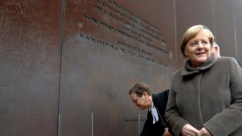 Thirty years after the Berlin Wall fell, Merkel said the event reminds 'that we have to do our part for freedom and democracy' [Fabrizio Bensch/Reuters]