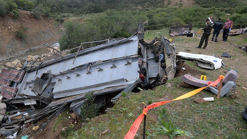 Security forces check the debris of a bus that plunged into a ravine, in Ain Snoussi region [Fethi Belaid/AFP]