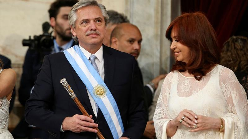 Argentina's new President Alberto Fernandez holding the symbolic leader's staff, next to new Vice President Cristina Fernandez de Kirchner,  in Buenos Aires, Argentina [Agustin Marcarian/Reuters]