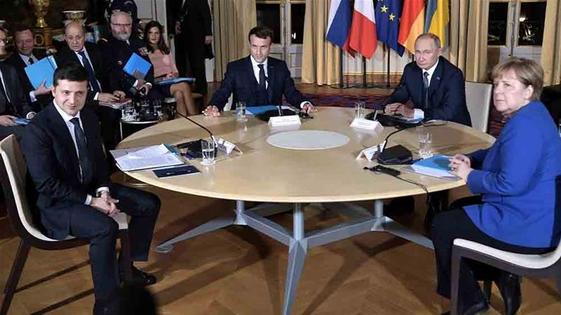 The leaders of France, Germany, Russia and Ukraine agreed to implement a full ceasefire this month at a meeting in Paris [Reuters]