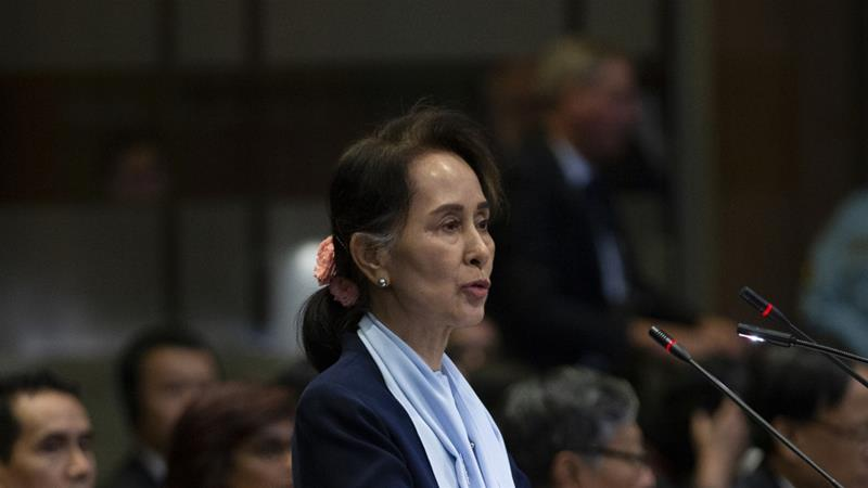 Aung San Suu Kyi has shocked critics by travelling to The Hague to head her country's delegation [Peter Dejong/The Associated Press]