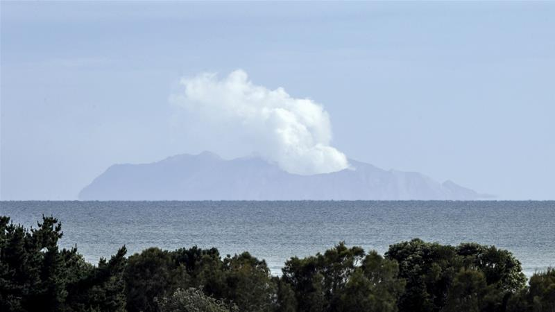 Plumes of steam rise above Whakaari Island on Wednesday, making it difficult to recover bodies of those who were killed during the eruption on Monday [Mark Baker/AP]