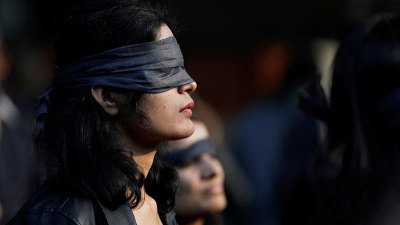 A protestor wearing a blindfold takes part in a protest in solidarity with rape victims and to oppose violence against women in India, in New Delhi, India December 7, 2019 [Adnan Abidi/Reuters]