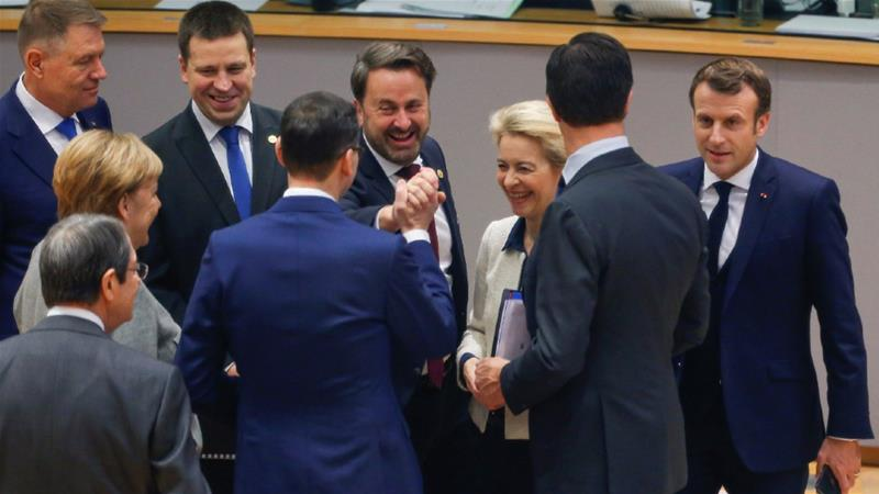 Romania's Klaus Iohannis, Estonia's Juri Ratas, Luxembourg's Xavier Bettel, Mark Rutte of the Netherlands, France's Emmanuel Macron, Germany's Angela Merkel, Slovenia's Marjan Sarec, Nicos Anastasiades of Cyprus and European Commission President Ursula von der Leyen [Julien Warnand/Pool/Reuters]