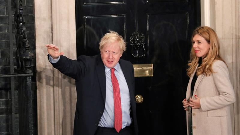 Britain's Prime Minister Boris Johnson and his girlfriend Carrie Symonds arrive at 10 Downing Street on the morning after the general election in London, Britain, December 13, 2019 [Thomas Mukoya/Reuters]