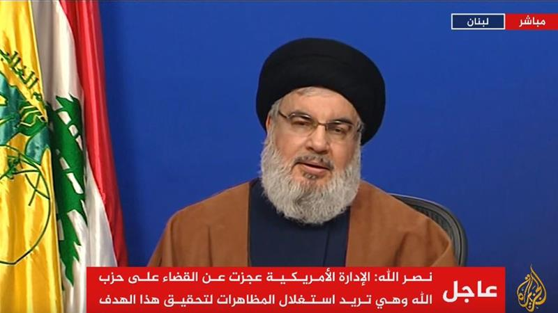 In a televised address, Hezbollah leader Hassan Nasrallah insisted on Lebanon's largest Christian political bloc to take part in cabinet [Al Jazeera screenshot]