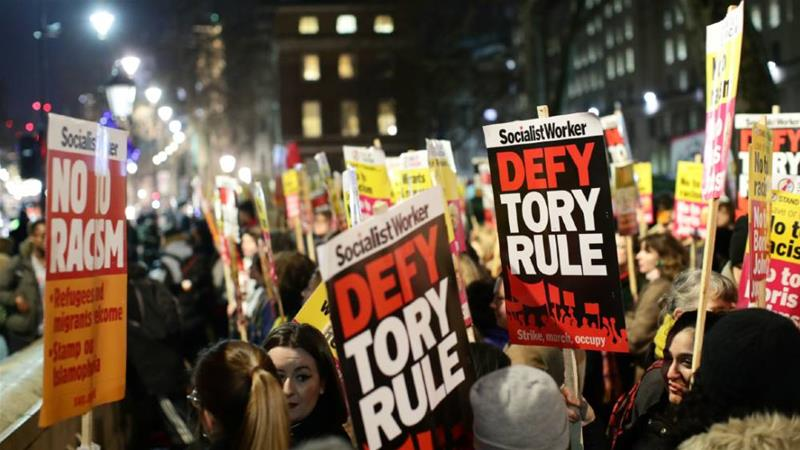 Protesters demonstrate at Downing Street after the Conservatives won the UK's general election in a landslide [Lisi Niesner/Reuters]